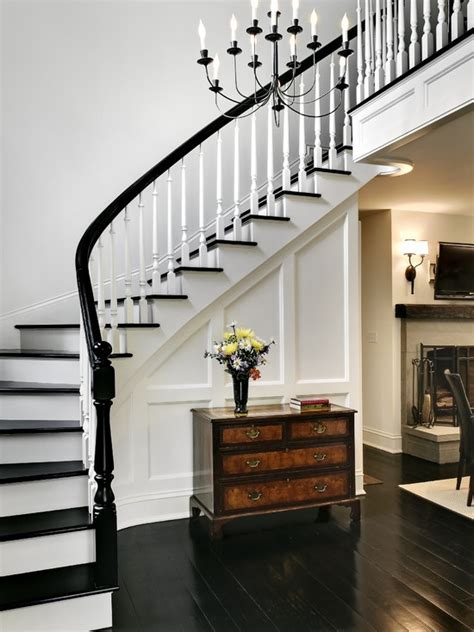 dark wood banister black and white stair case stairwell pinterest dark