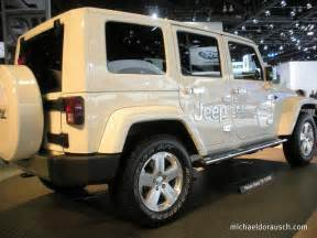 jeep wrangler four door all white with a white top