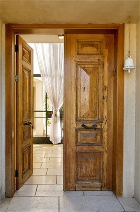 rustic tuscan hacienda master bedroom doors
