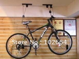 How To Hang Bicycles From The Ceiling by Bicycle Hoist Garage Ceiling Lift Pulley Bike Racks