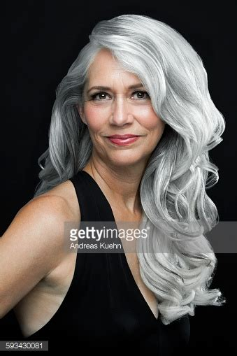 young black women with gray hair styles woman with long wavy gray hair portrait stock photo