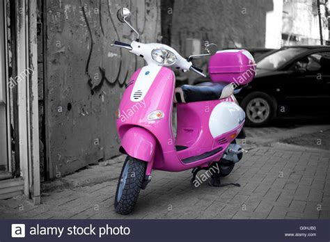 wallpaper vespa pink pink vespa motorcycle scooter on black and white street