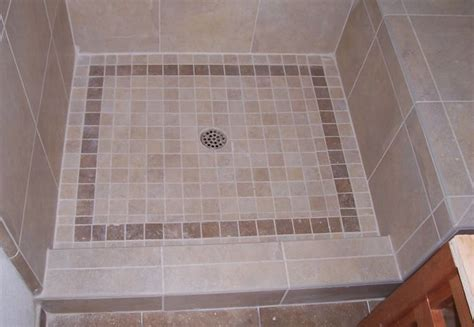install tile floor in bathroom how to put tile on an acrylic shower pan bathroom