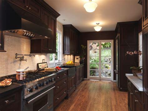 amazing brown cabinets  granite countertop light wood floor