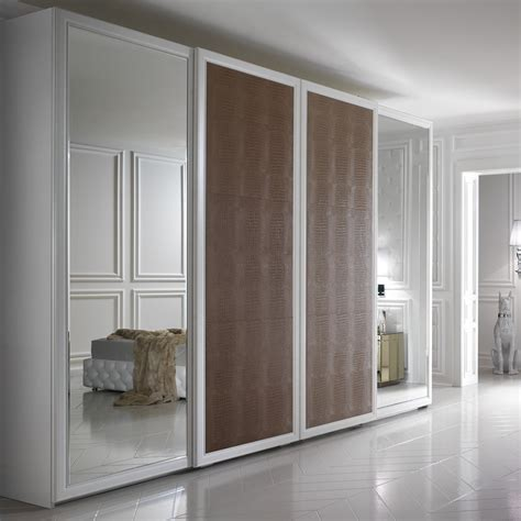 Wardrobes Fitted - large alligator embossed leather sliding door fitted