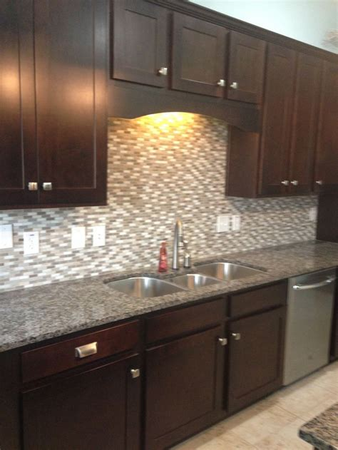 backsplash for dark cabinets white kitchen cabinets with new caledonia granite quicua com