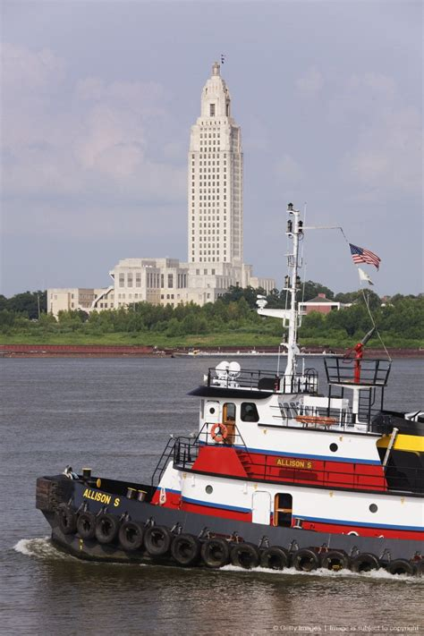 new orleans tugboat tugboat crossing by the louisiana state capitol building