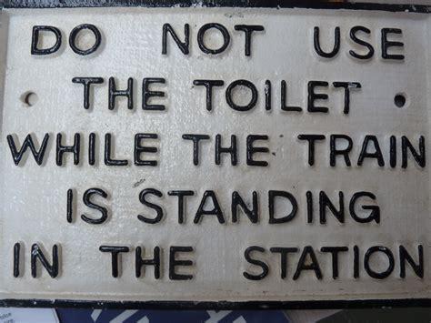 do not use bathroom signs do not use bathroom signs a cast iron railway sign do not
