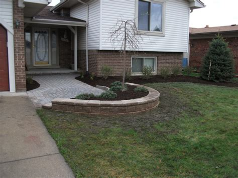building a paver patio retaining wall retaining wall total lawn care inc lawn maintenance lawn landscaping and snow