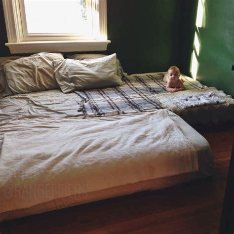 baby sleep co sleeping vs crib sleeping with mattress on floor flooring ideas and