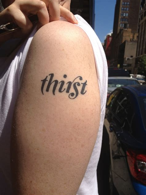 a different kind of body type typographic tattoos