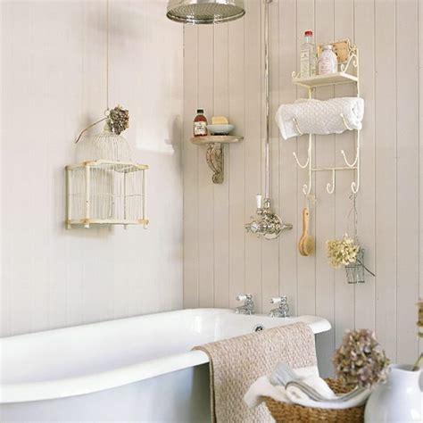 small cream panelled bathroom with birdcage small