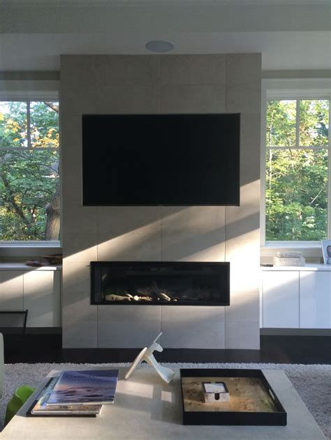 valor   linear direct vent fireplace installed   wall  wide screen tv