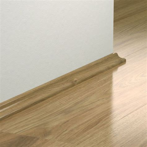 pergo laminate scotia is used around the edge of the room to hide the expansion gap required