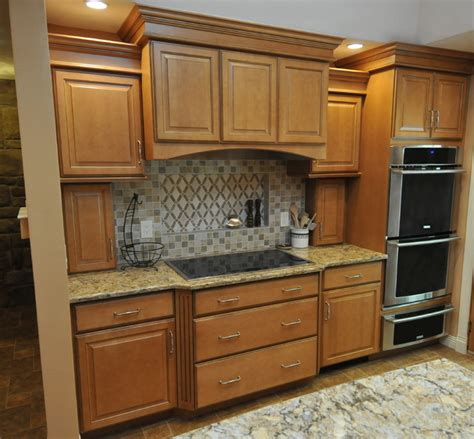 hand crafted glazed maple cabinets by custom corners llc honey maple glaze traditional kitchen new york by