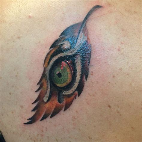 feather tattoo under eye 74 best things to wear images on pinterest tattoo legs