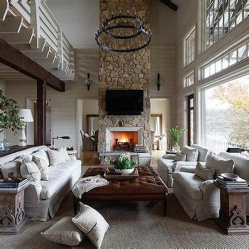 2 story living room country living room stone fireplace design ideas