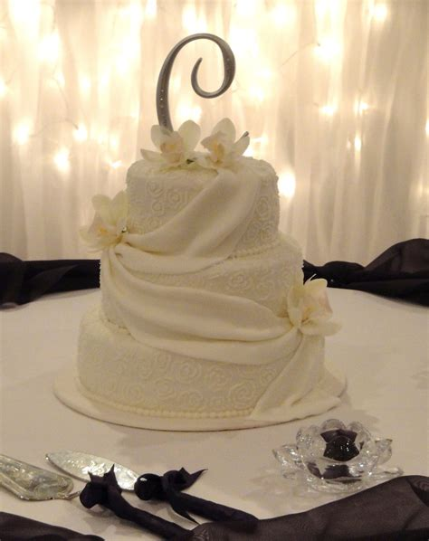 fondant draping fondant drapes white orchids and piped buttercream