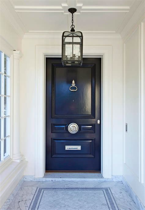 Black Door Hardware Exterior A White Marble Entrance At The Front Of The Home Leads To A Rich Navy Door With Silver Hardware