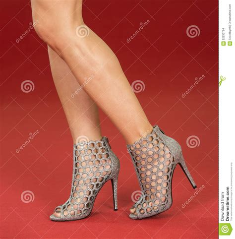how to put on a rug with leg straps legs in fancy high heels on the carpet stock photo image 62930724