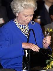queen elizabeth handbag secrets of the queen s handbag revealed in new book