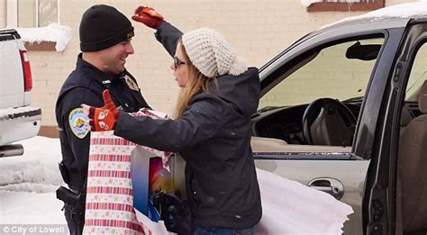 christmas present for cops michigan surprises drivers with gifts instead of tickets daily mail