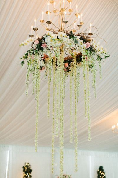 chandelier with flowers 25 best ideas about chandelier wedding on
