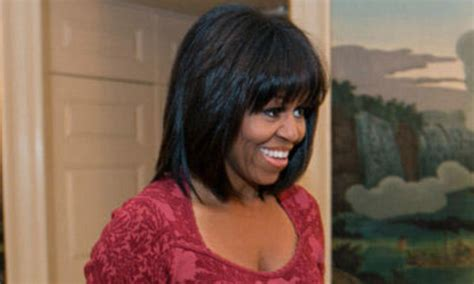 ms obamas new hair do bangs for her birthday michelle obama debuts new blunt