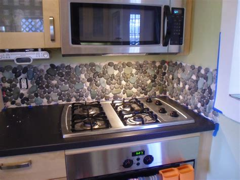 how to do backsplash in kitchen river rock backsplash give a new and natural accent to