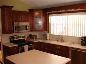 Caring For Corian Countertops Timberlake Cherry Kitchen With Corian Sahara Countertops