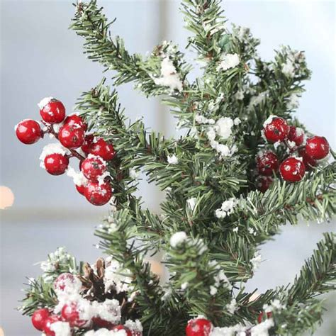 snowy artificial berry pine tree christmas trees and