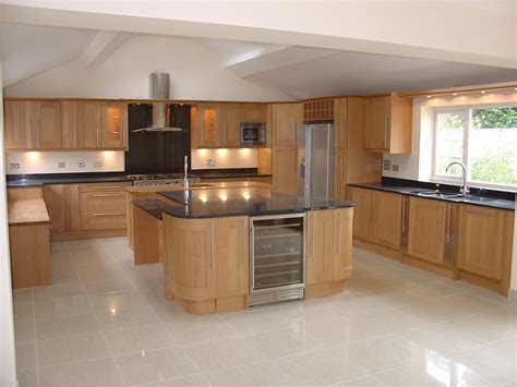 Built In Kitchen Designs by Shaker Style Oak Kitchen With Angola Black Granite