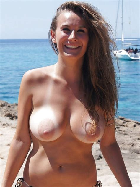 Beautiful Lady With Big Boobs Topless On The Beach Photo