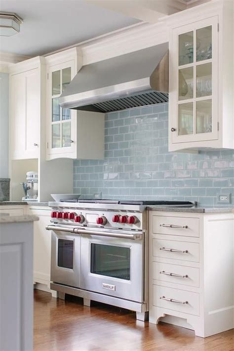 light blue kitchen backsplash white and blue kitchen features a coffered ceiling with