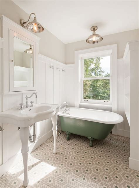 clawfoot tub bathroom designs traditional bathroom with console sink flush light