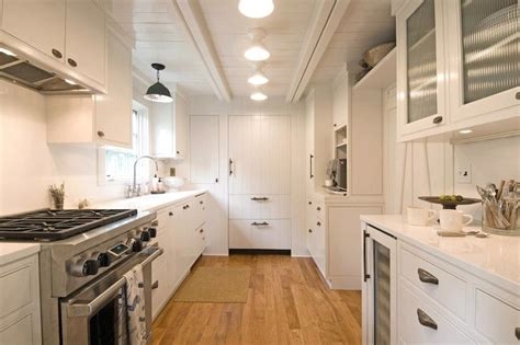 galley kitchen lighting white plank ceiling cottage kitchen hton design