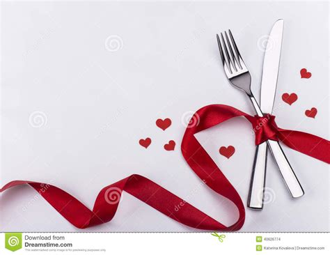 Christmas Place Settings by Fork And Knife For Wedding Celebration Background Stock