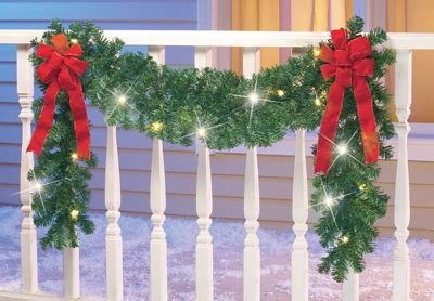 images of christmas garland on a fences lighted fence garland with bows from collections etc