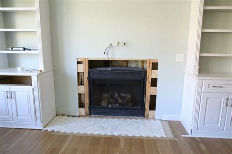 tile fireplace surround how to install a marble herringbone fireplace surround and