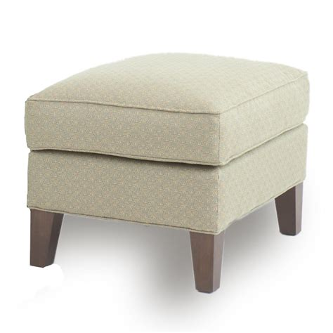ottoman with tapered wood legs