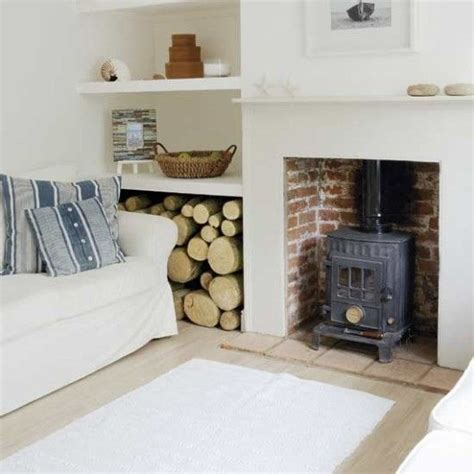 wood burner in living room cosy log burner brick interior plain white surround and mantle few tiles as a hearth for