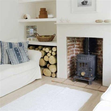 fireplace log storage log store beside breast fireplace ideas