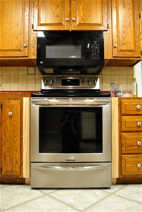 Where To Put Things In Kitchen Cabinets Filling Gaps Around The Stove With Trim Amp Other Little