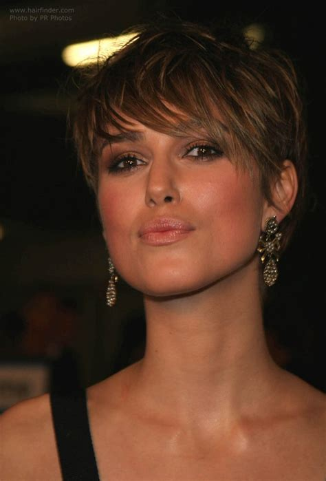 bangs for volume at crown keira knightley with her hair cut short with extra long bangs