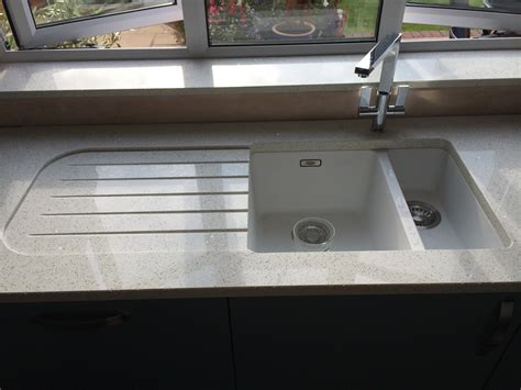 quartz undermount kitchen sinks franke kubos sink with recessed drainer in quartz worktop