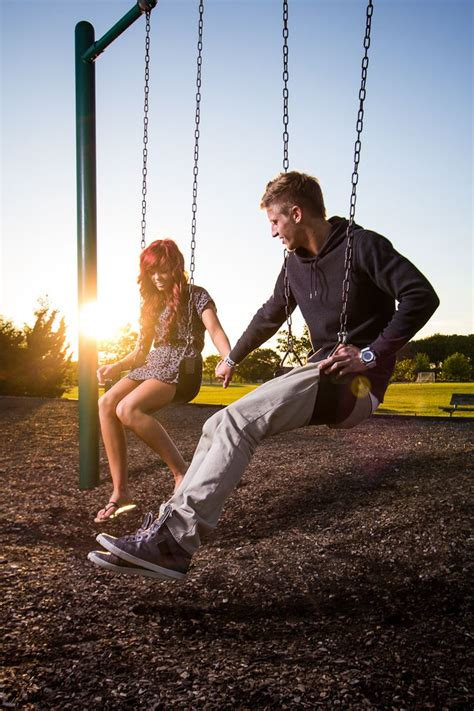 couples swing couples portrait at the park swing set