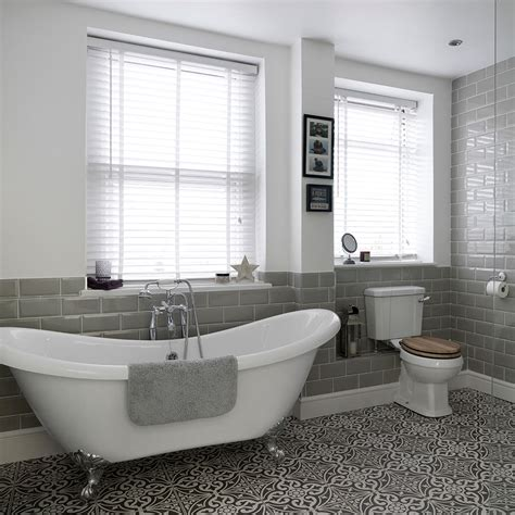 roll top bathrooms bathroom with roll top bath and patterned floor tiles