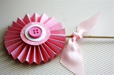 Folded Paper Decorations - accordion folded paper flower decorations
