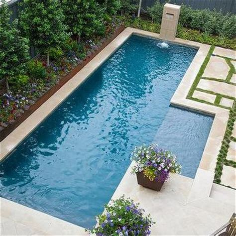inground pool fountains backyard with inset fountain transitional home exterior