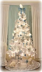 tree silver white: no presents under the tree yet because last year my dogs decided to